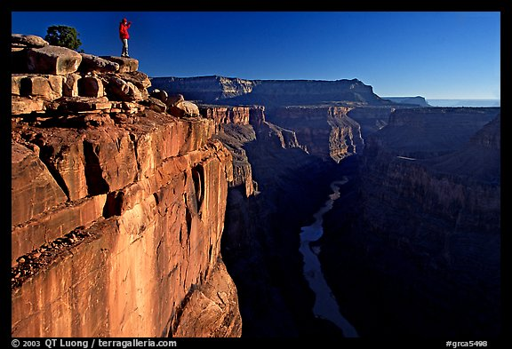 Hiker looking down into  Grand Canyon at Toroweap, early morning. Grand Canyon National Park (color)