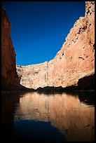 Steep limestone canyon walls reflected in Colorado River, early morning. Grand Canyon National Park ( color)