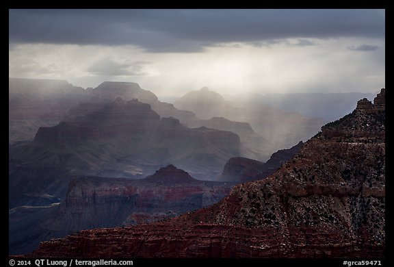 Canyon ridges with dramatic clouds and sunrays. Grand Canyon National Park (color)