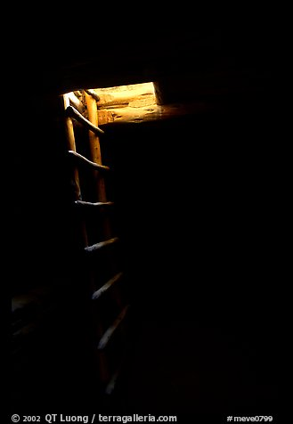 Dark kiva room with Ladder through light opening, Spruce Tree house. Mesa Verde National Park (color)
