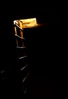 Dark kiva room with Ladder through light opening, Spruce Tree house. Mesa Verde National Park, Colorado, USA. (color)