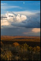 Moon, thunderstorm cloud over mesas at sunset. Mesa Verde National Park, Colorado, USA. (color)