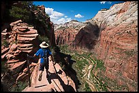 Hiker stepping next to sheer cliff, Angels Landing. Zion National Park ( color)