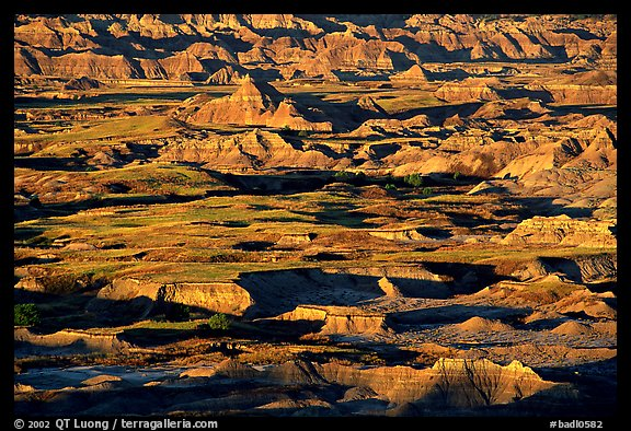 Badland ridges and prairie from above, sunrise. Badlands National Park, South Dakota, USA.