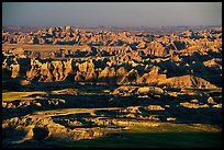 View over eroded ridges from Pinacles overlook, sunrise. Badlands National Park, South Dakota, USA. (color)