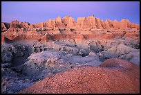 Cracked mud and erosion formations, Cedar Pass, dawn. Badlands National Park, South Dakota, USA.