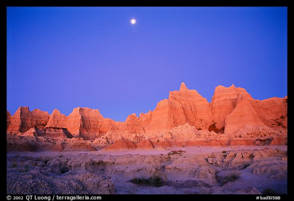 Moon and eroded badlands, Cedar Pass, dawn. Badlands National Park (color)