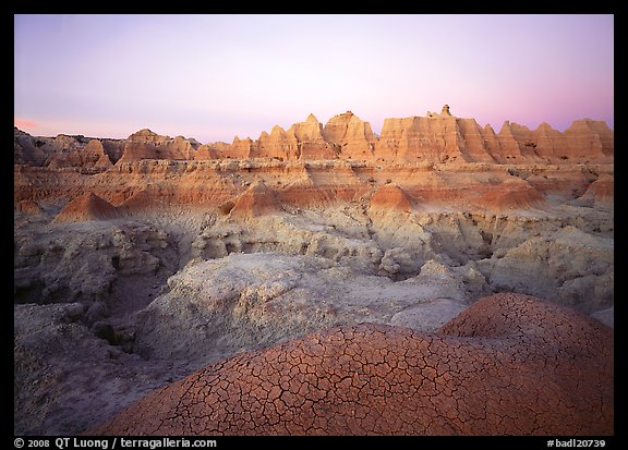 Cracked mudstone and eroded towers near Cedar Pass, dawn. Badlands National Park (color)