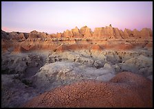 Cracked mudstone and eroded towers near Cedar Pass, dawn. Badlands National Park ( color)