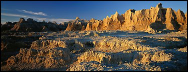 Badlands towers and pinacles, early morning. Badlands National Park (Panoramic color)