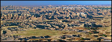 Prairie mixed with badland ridges. Badlands National Park (Panoramic color)