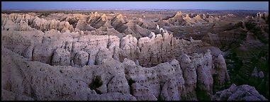 Eroded badland scenery at dusk, Stronghold Unit. Badlands National Park (Panoramic color)