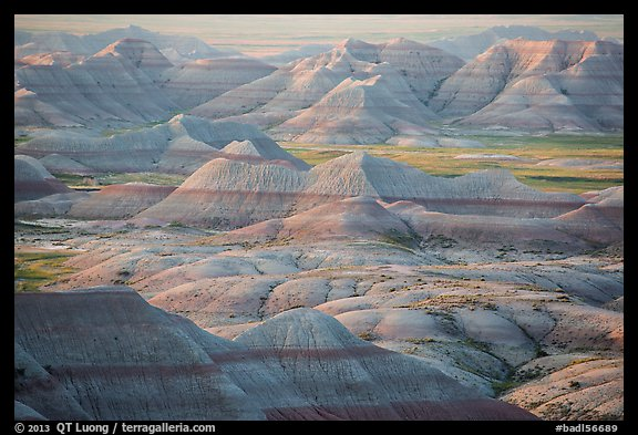 Delicately colored badlands and prairie at sunrise. Badlands National Park (color)