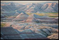 Delicately colored badlands and prairie at sunrise. Badlands National Park ( color)