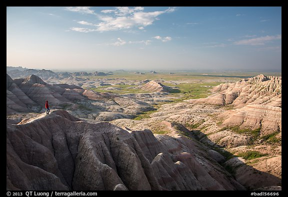 Park visitor looking, Panorama Point. Badlands National Park (color)