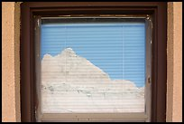 Butte, Window reflexion, Badlands National Park Headquarters. Badlands National Park ( color)