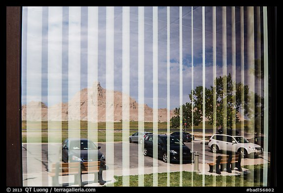Badlands and parking lot, Visitor Center window reflexion. Badlands National Park (color)