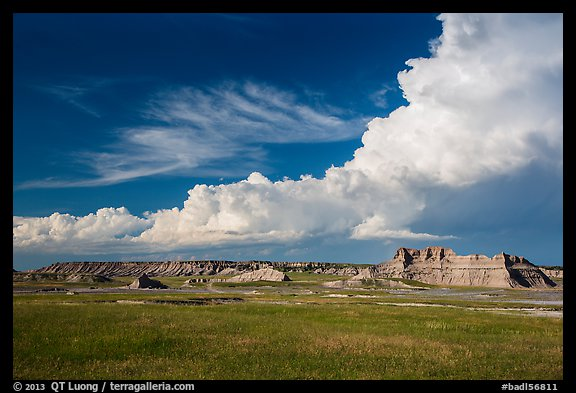 Afternoon clouds above buttes and prairie, South Unit. Badlands National Park (color)