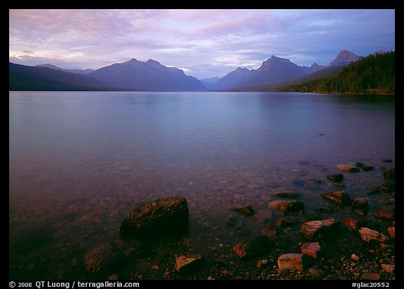 Rocks, Lake Mc Donald, and mountains at sunset. Glacier National Park (color)