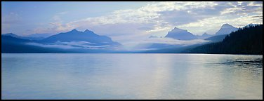 Serene lake with clouds hanging over mountains. Glacier National Park, Montana, USA.
