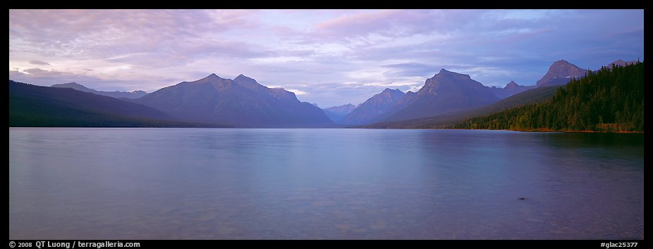 Mountains rising above calm lake in the evening. Glacier National Park (color)