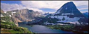 Alpine lake and triangular peak. Glacier National Park, Montana, USA.