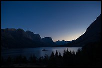 St Mary Lake at night with stars. Glacier National Park, Montana, USA.