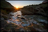 Outlet stream of Swiftcurrent Lake, sunrise. Glacier National Park, Montana, USA. (color)