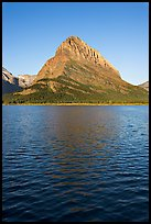 Grinnell Point across Swiftcurrent Lake, sunrise. Glacier National Park, Montana, USA.