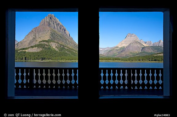 Grinnell Point and Swiftcurrent Lake framed by windows of Many Glacier Lodge. Glacier National Park, Montana, USA.