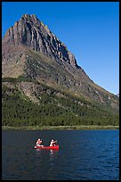 Red canoe on Swiftcurrent Lake. Glacier National Park, Montana, USA.