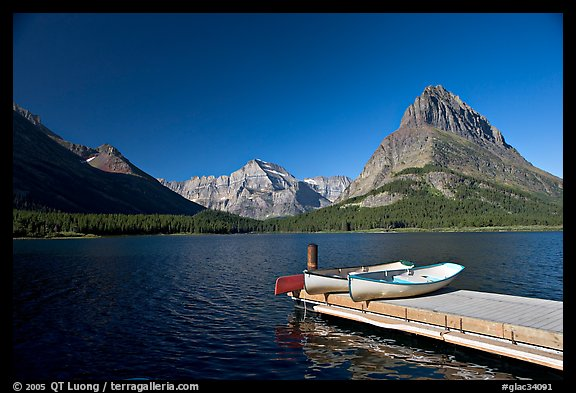 Deck and small boats on Swiftcurrent Lake. Glacier National Park (color)
