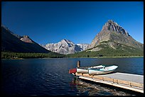 Deck and small boats on Swiftcurrent Lake. Glacier National Park, Montana, USA.