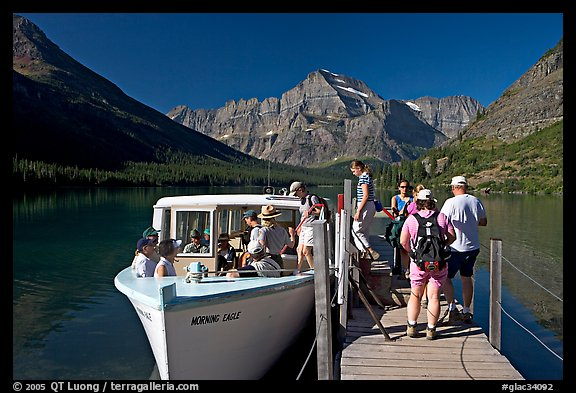 Passengers embarking on tour boat at the end of Lake Josephine. Glacier National Park (color)