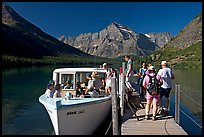 Passengers embarking on tour boat at the end of Lake Josephine. Glacier National Park, Montana, USA.