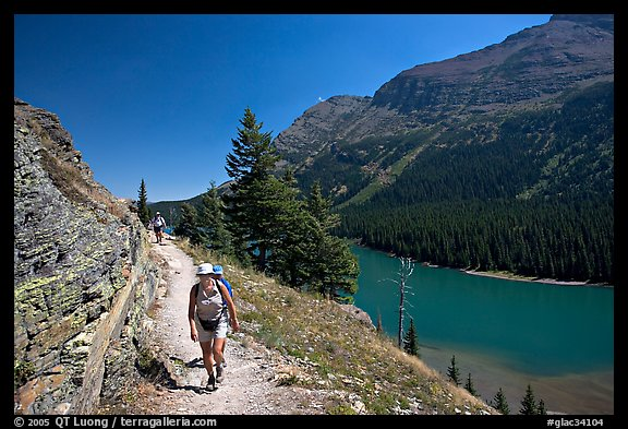 Hikers on trail above Lake Josephine. Glacier National Park, Montana, USA.
