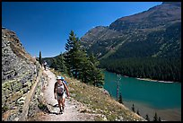 Hikers on trail above Lake Josephine. Glacier National Park, Montana, USA. (color)