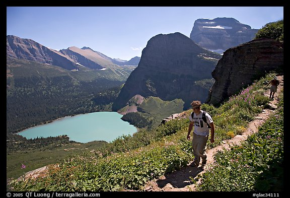 Hikers on trail overlooking Grinnell Lake. Glacier National Park (color)