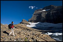 Hiker on moraine near Grinnell Glacier. Glacier National Park, Montana, USA.