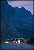 Many Glacier lodge and Swiftcurrent Lake at dusk. Glacier National Park, Montana, USA.