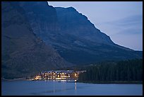 Swiftcurrent Lake and Many Glacier Lodge lights at dusk. Glacier National Park, Montana, USA. (color)
