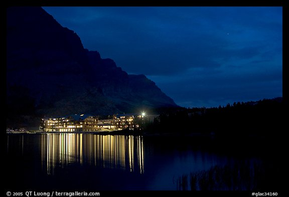 Many Glacier lodge lights reflected in Swiftcurrent Lake at night. Glacier National Park (color)