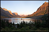 St Mary Lake, Going-to-the-sun Mountain, and Lewis Range, sunrise. Glacier National Park, Montana, USA.