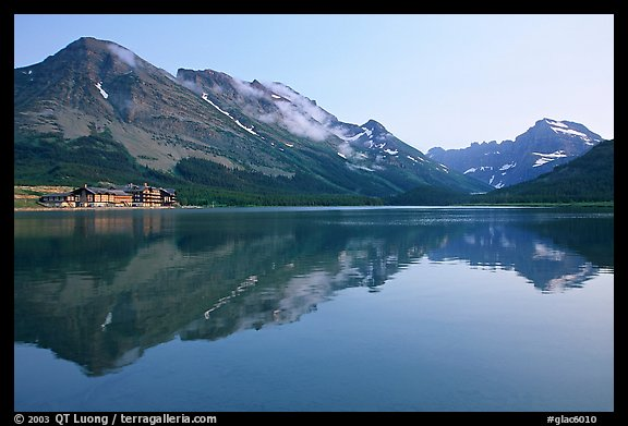 Many Glacier Hotel reflected in Swiftcurrent Lake. Glacier National Park, Montana, USA.
