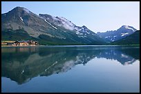 Many Glacier Hotel reflected in Swiftcurrent Lake. Glacier National Park, Montana, USA. (color)