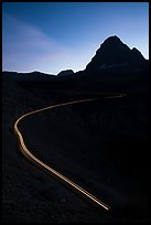 Going-to-the-Sun road at dusk with car light trail. Glacier National Park ( color)