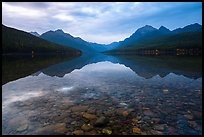 Submerged rocks and mountain reflected, Bowman Lake. Glacier National Park ( color)