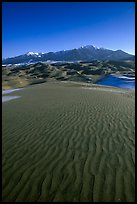 Sand ripples and Sangre de Christo mountains in winter. Great Sand Dunes National Park and Preserve, Colorado, USA.