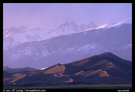 Distant view of the dune field and Sangre de Christo mountains at sunset. Great Sand Dunes National Park and Preserve (color)