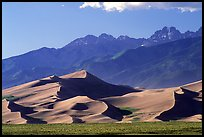 Distant view of Dunes and Crestone Peaks in late afternoon. Great Sand Dunes National Park, Colorado, USA.